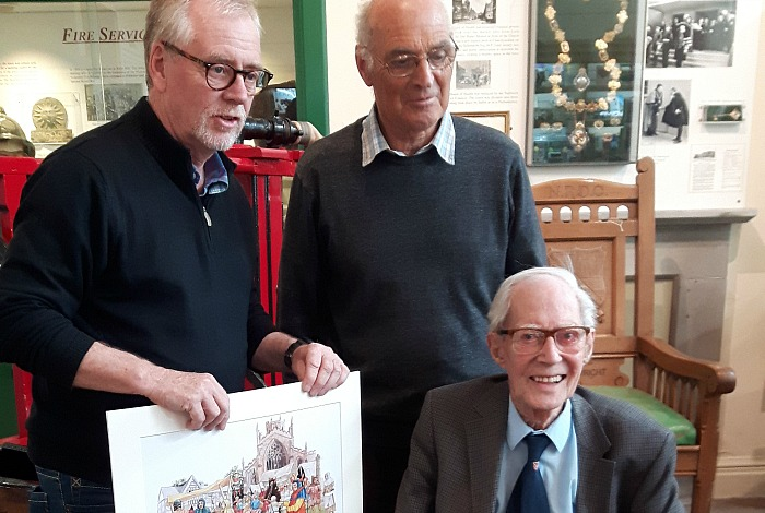 volunteer - Chair of Nantwich Museum Trustees, Nick Dyer presents Allan Whatley with a painting Nantwich Medieval Market as local historian