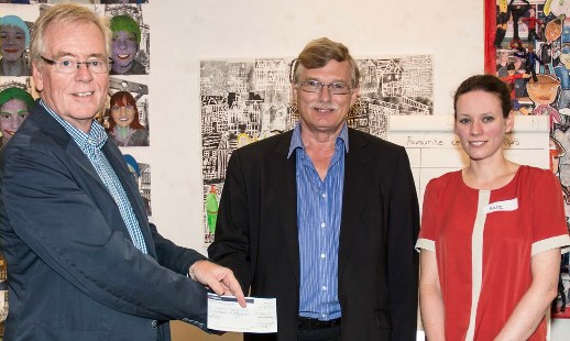 Chair of the Museum Trust, Nick Dyer (left), receives the cheque from Tim Ashworth as Museum Manager, Kate Dobson, looks on