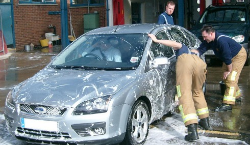 Nantwich firefighters splash out with charity car wash
