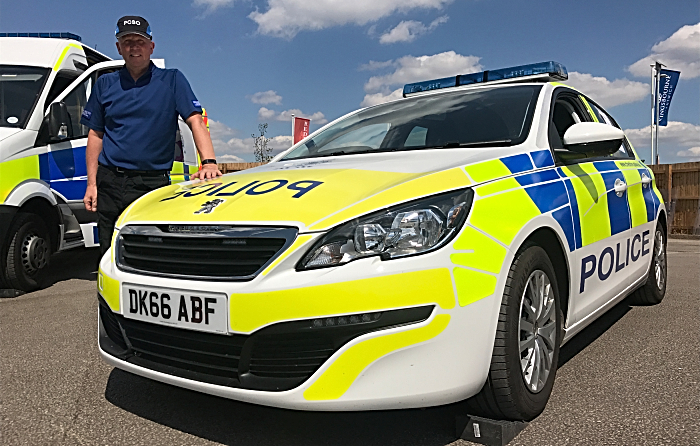 Emergency Services Day - Cheshire Constabulary - PCSO Nick Jarvis with a police car (1)