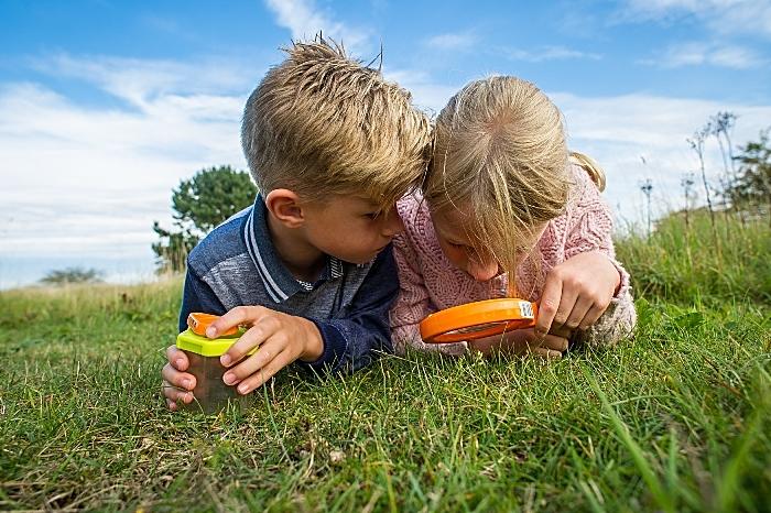 Cheshire Wildlife Trust breakfast challenge - Children exploring with magnifier (c) Matthew Roberts