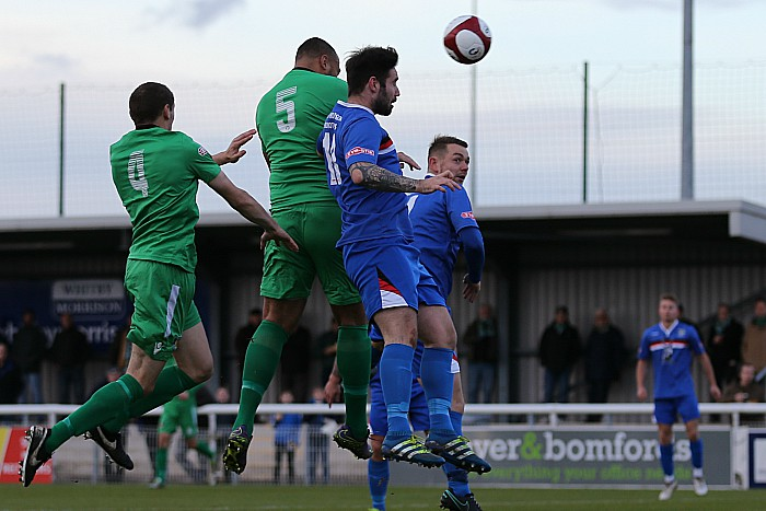 Clayton McDonald heads home the winning goal v Whitby