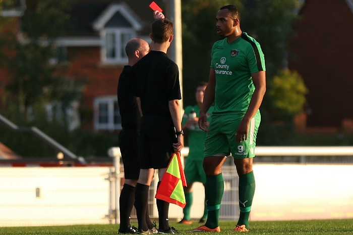 Clayton McDonald receives a red card against Newcastle Town