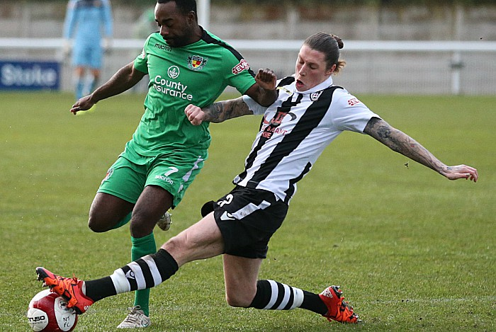 Coalville defender Lee Torr tackles the ball from Joe Mwasile