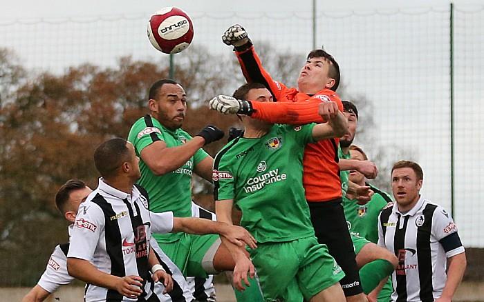 Coalville keeper Matt Coton clears the ball