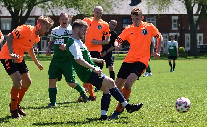 Cuddington player passes the ball under pressure from the Pirates (1)