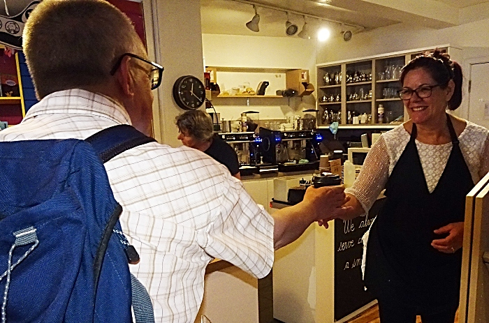 Customer Mark Ray receives his latte from Denise Lawson at Nantwich Bookshop and Coffee Lounge (1)