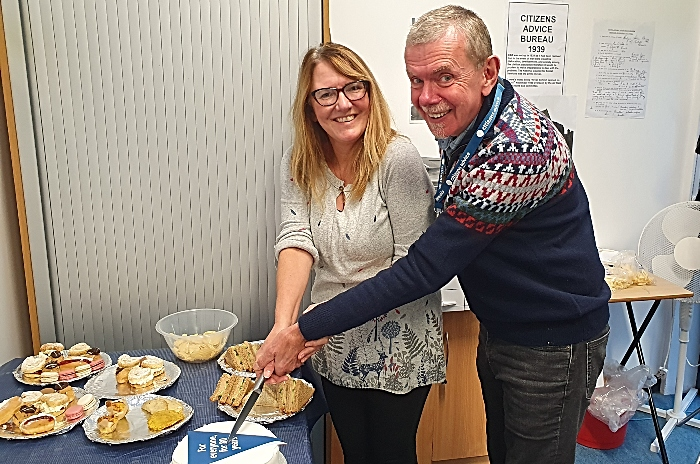 Cutting the 80th birthday cake in Citizens Advice Cheshire East's Nantwich office to mark 80 years of Citizens Advice in Cheshire East (1)
