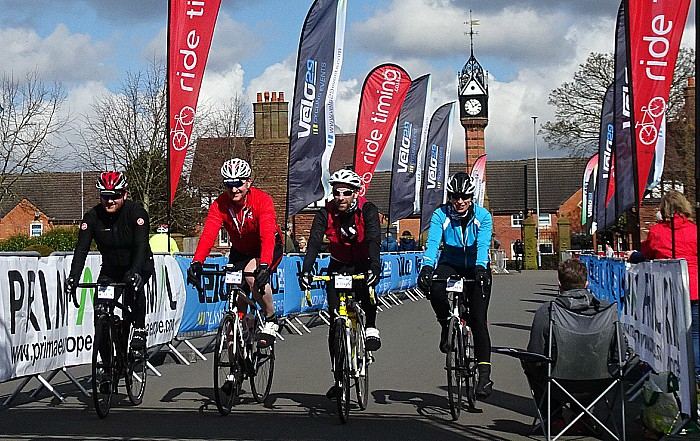 Sportive - Cyclists cross the finish line within Queens Park Crewe