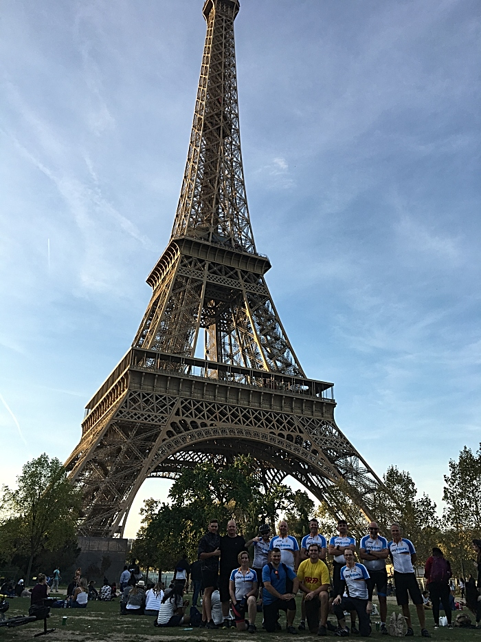 Cyclists finish their ride at the Eiffel Tower in Paris (1)