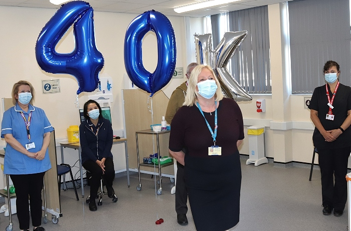 Denise Frodsham (front centre) thanks the team after reaching 40k vaccinations (1)