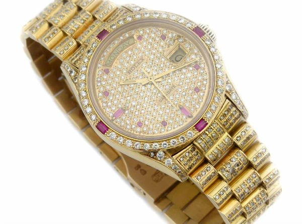 Diamond_and_ruby_encrusted_gold_Rolex_President_£7500