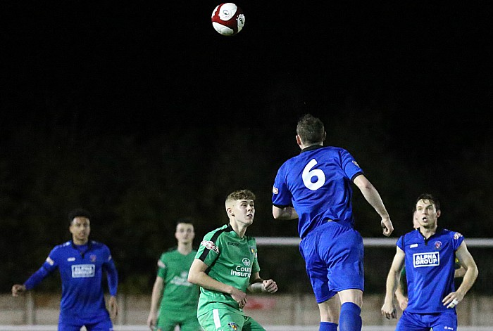 Droylsden player Danny Ventre heads the ball