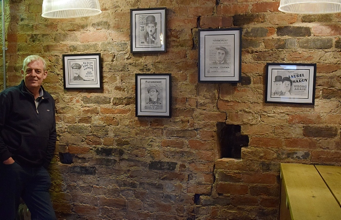 Ebenezer's Craft Beer & Gin - Tony Winterbottom poses next to his artwork display (1)