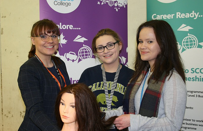 careers - Elena Bonam and Georgina Gwinn try out their hairdressing skills, watched over by Julia Sanders from South Cheshire College Arts, Business and Services Department