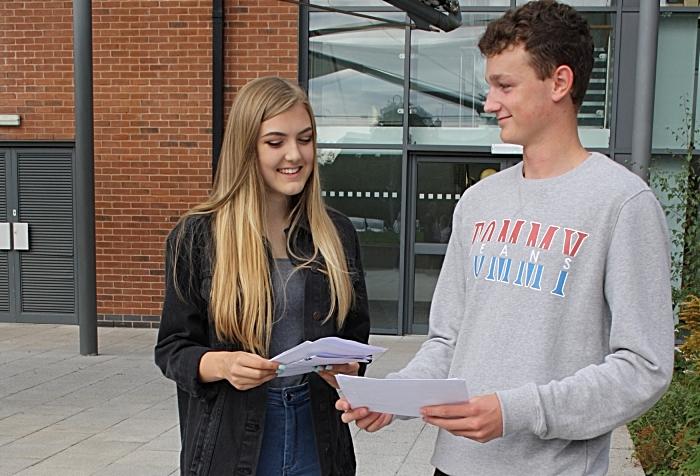 Emily Inskip and Jack Wilne compare their results - Brine Leas