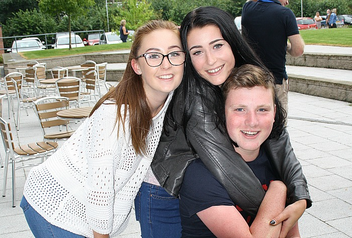 Emily Young and Gemma Read give Calum Parry a hug and pat on the back