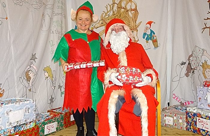 Father Christmas and elf helper