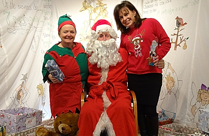Father Christmas and helpers at his Grotto - Xmas Fair
