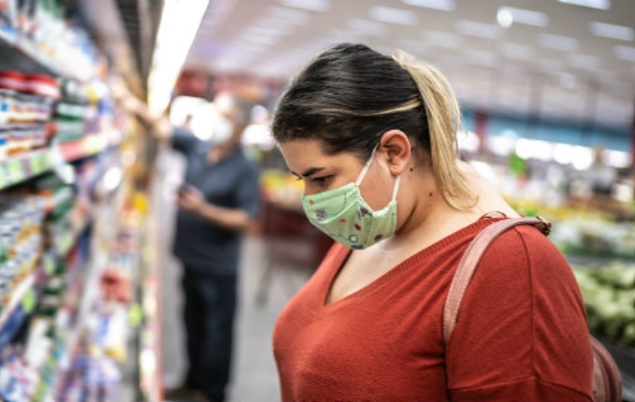 Female shopper wearing a face covering