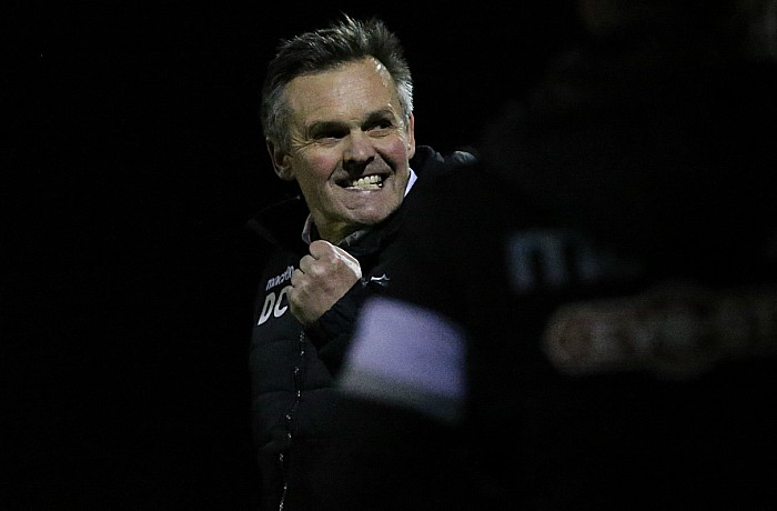 Final whistle - Manager Dave Cooke punches the air in celebration