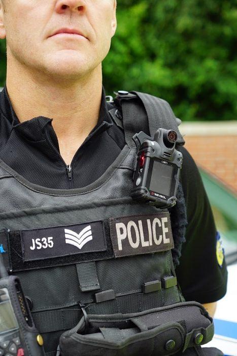 Firearms officer wearing body worn video camera