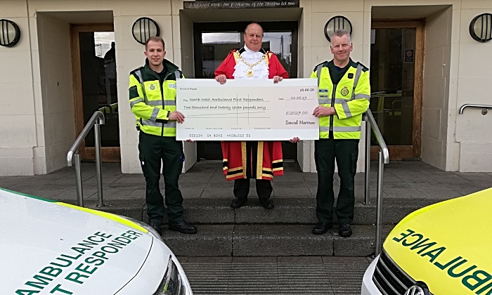 first responders cheque from mayor's charity