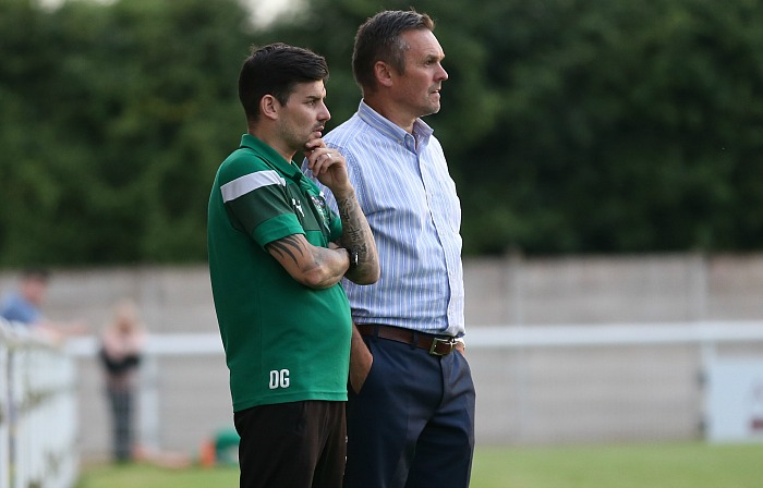 at Rushall Olympic - First Team Manager Dave Cooke and Assistant Manager Danny Griggs assess the action