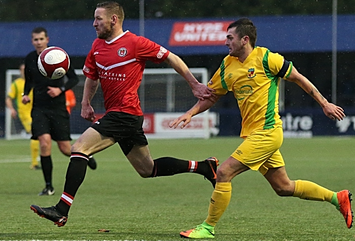 First-half - Caspar Hughes challenges for the ball