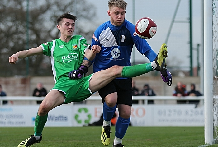 First-half - Joe Malkin challenges for the ball from Grantham keeper Sam Andrew (1)