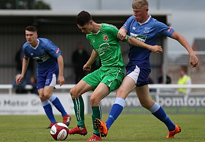 First-half - Joe Malkin on the ball under pressure from Leek Town (1)