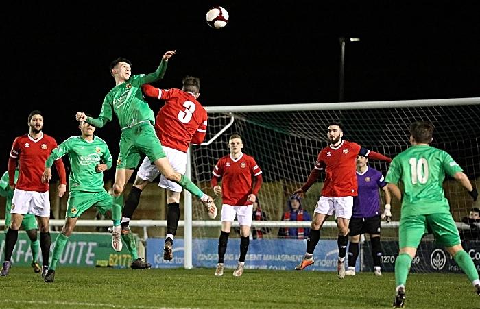 First-half - Joe Malkin wins a header under pressure from FCUM (1)