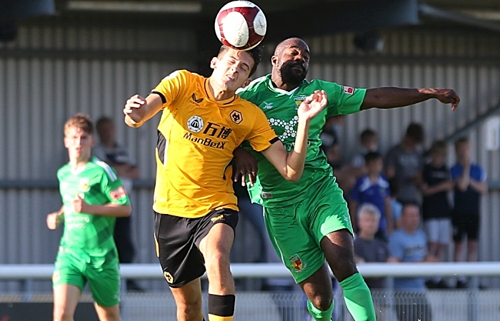 First-half - Joe Mwasile challenges for the ball (1)