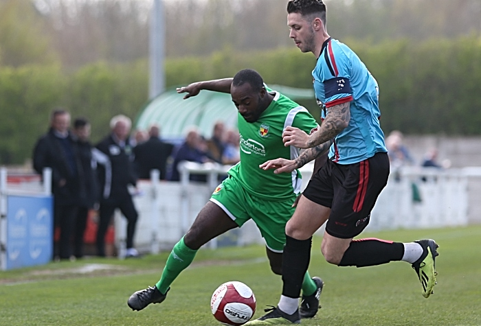 First-half - Joe Mwasile fights for the ball (1)