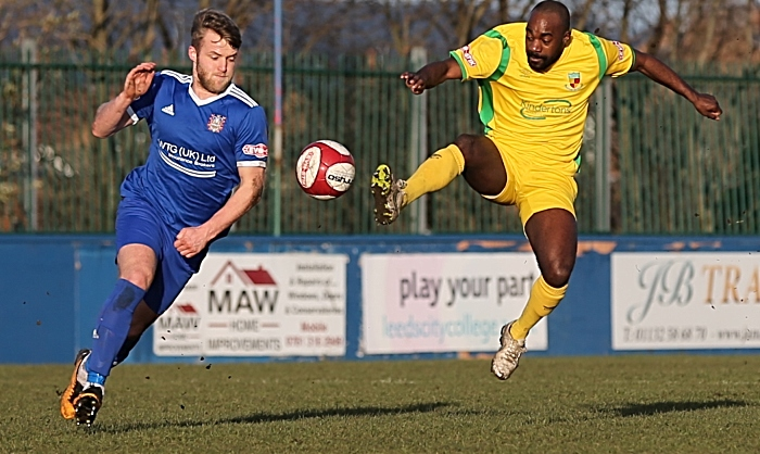 First-half - Joe Mwasile fights for the ball