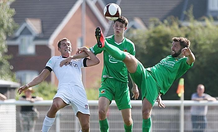 First-half - Nantwich Towns Joe Davis gets to the ball first (1)