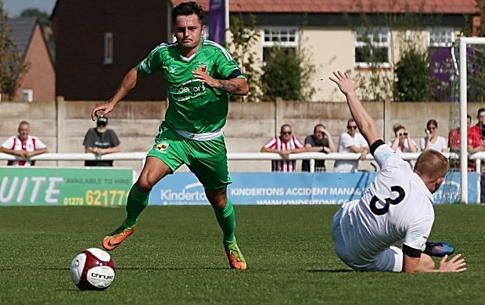 First-half - captain Caspar Hughes wrong-foots Witton defender James Short leaving him on the deck (1)