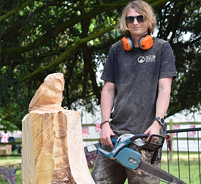 Former Reaseheath College student Paul Edwards poses with his chainsaw sculpture