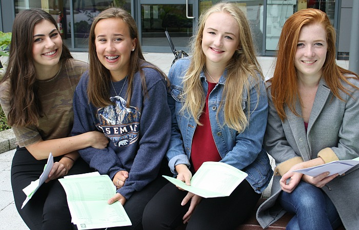 Friends, Orla Nutkins, Sophie Stringer, Beth Kilby and Rachel Hadfield relax together now that the GCSE wait is over