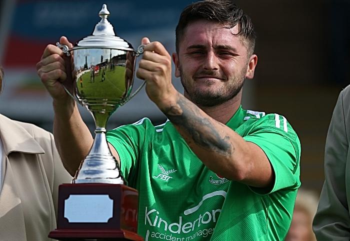 Full-time - Caspar Hughes raises the Barry Daly Memorial Trophy (1)