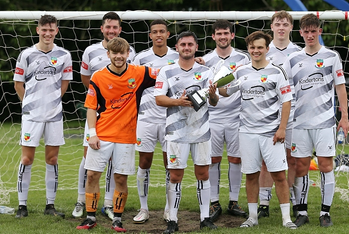 Full-time - All Stars v Nantwich Town FC captain Caspar Hughes (centre) with trophy and team (1)