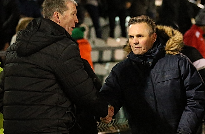 Full-time - Nantwich Town Manager Dave Cooke shakes hands with Stockport County Manager Jim Gannon (1)
