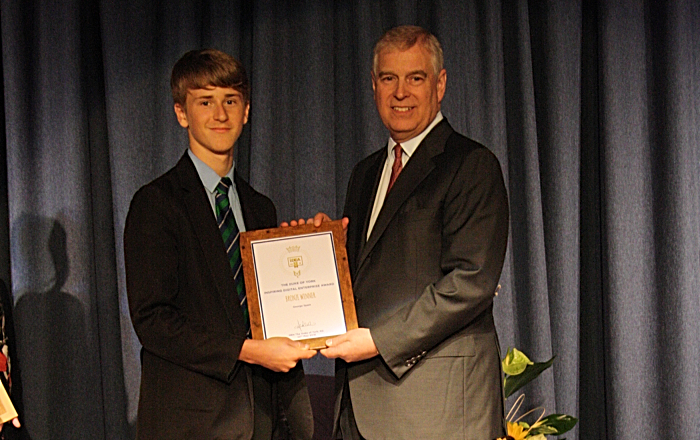 George Spain is presented with his Bronze certificate