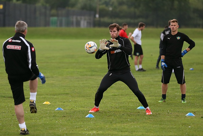 Training - Goalkeeper Fabian Spiess saves the ball from goalkeeping coach Paddy