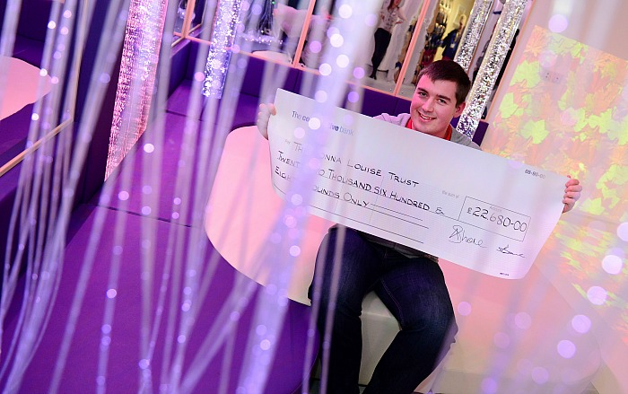 Graham Witter with his cheque in the fully refurbished sensory room