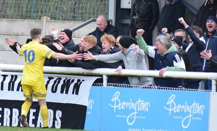 Grantham goalscorer Lee Shaw celebrates with fans