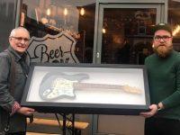 Beerdock boss raises £3,500 with The Buzzcocks guitar raffle
