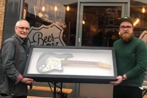 Beerdock boss raises £3,500 with The Buzzcocks guitar raffle
