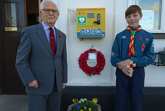 Wistaston Hall President John Cooke places wreath and Scout George Edge-Robinson places a cross at the front of the Hall