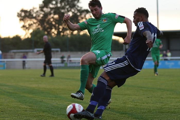 Rhyl - Harry Clayton attempts to intercept a pass